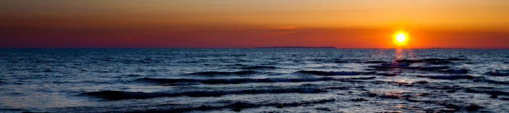 Sunset as seen from Fisherman's Island, with North and South Fox Islands just barely visible on the horizon. Fisherman's Island State Park, Charlevoix, by Jansen Photography