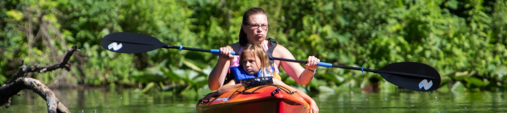 Mother and daughter kayaking on Eagle Lake in Fort Custer State Park, Battle Creek, by Jansen Photography